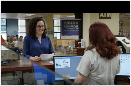 An employee assists a customer in a screenshot from the video series.